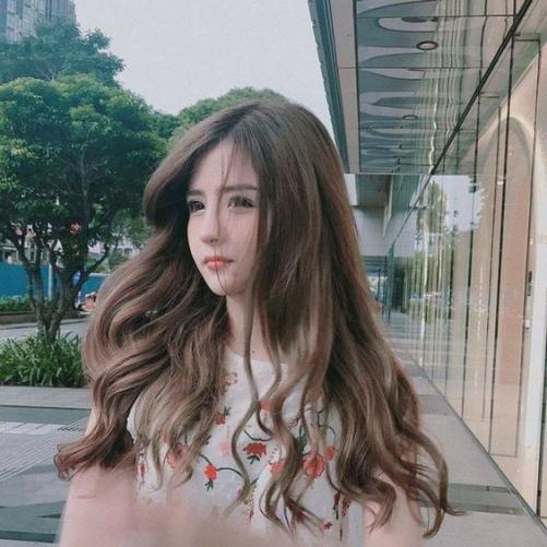 Cách cắt tóc dàiuốn quyến rũ cho nữ