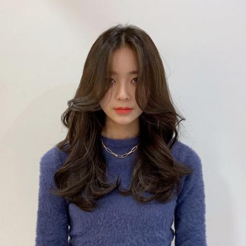 Tóc dài uốn đuôi