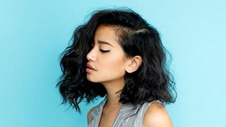 Heavy side swept lob hair with low taper fade