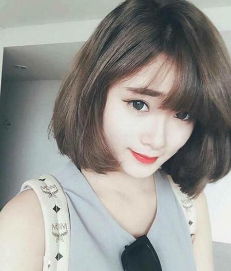 Kiểu tóc ngắn uốn đẹp cho mặt tròn