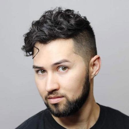 curly hair undercut man bun